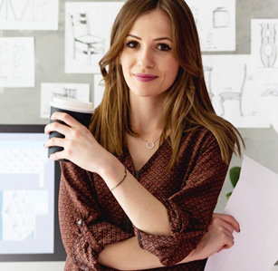 A business woman holding a  paper and coffee mug