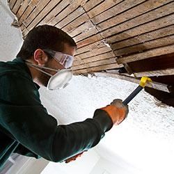 Man repairing ceiling