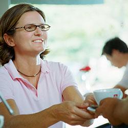 Woman serving coffee